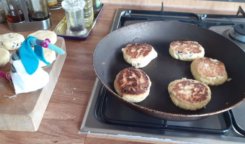 The cakes are turned over in the pan, showing their cooked sides