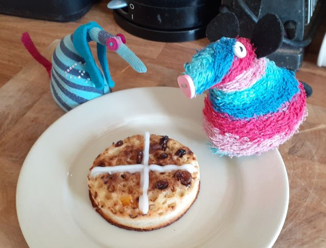 Ratvaark and Ofelia show off the crumpet with a white cross iced on top