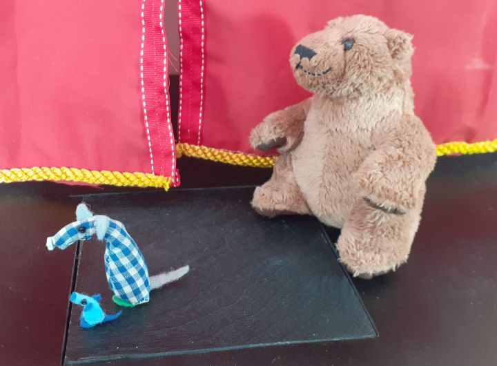Micro and Nano flee from a soft toy bear