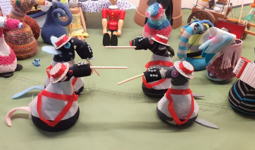 4 vaarks are dressed as Morris Dancers, with bells on their snozzles, boater hats and carrying sticks