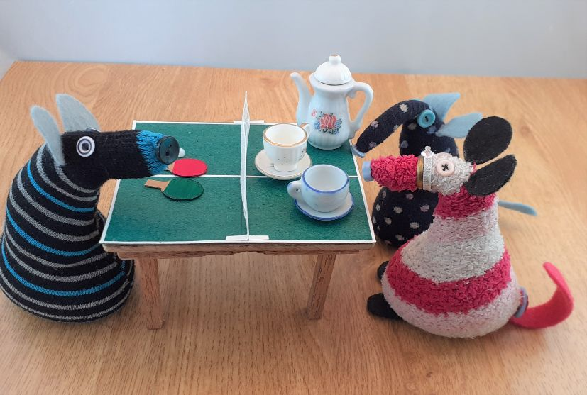 matilda has placed a teapot and cups on the table