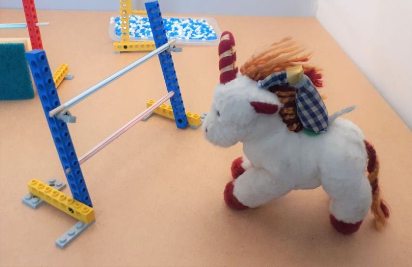 Micro rides a toy unicorn to the first jump