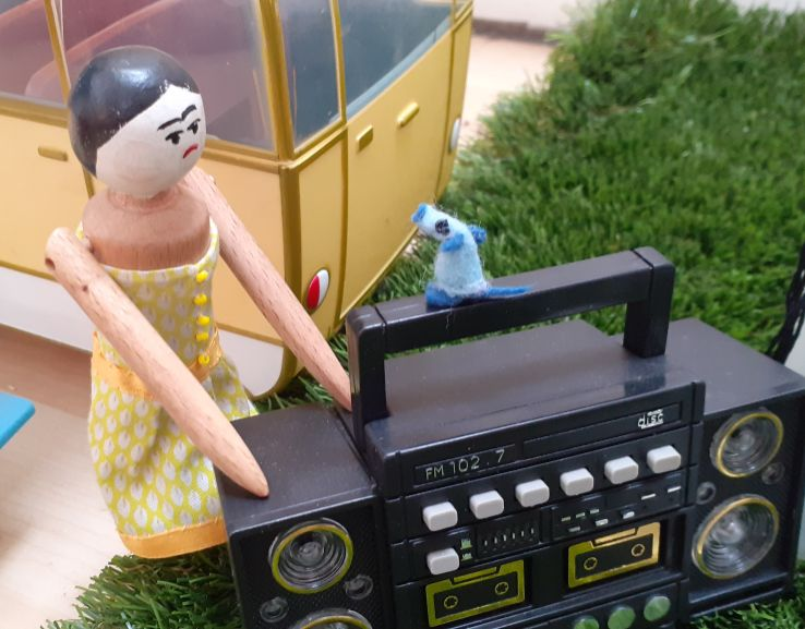 Peggy talks to Nano as he sits on the handle of the ghetto blaster