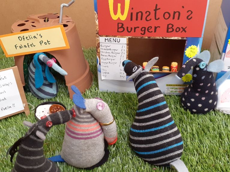 Winston nips next door to the burger stall, where a queue has formed.