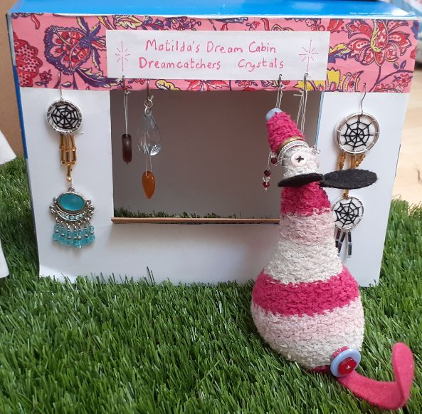 Matilda organises the crystals hanging from her stall