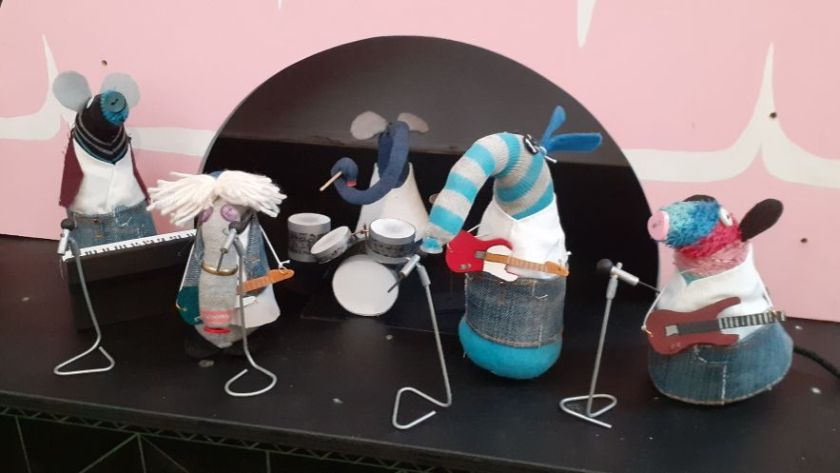 Hypno Dim Ernest Arnold and Ratvaark are dressed in denim, and playing instruments as Status Quo.