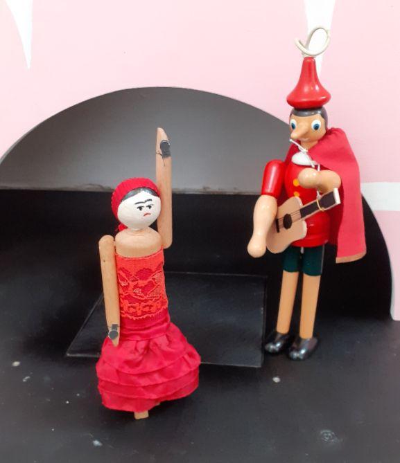 Peggy dances as Gino plays