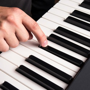 finger and piano keys