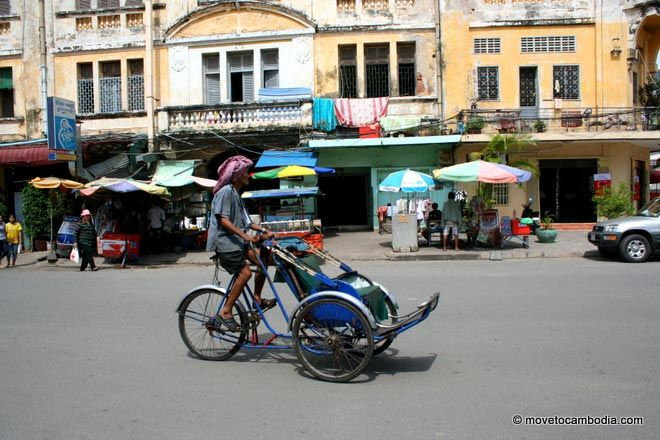 A cyclo driver slowly wheels around Phnom Penh, Cambodia.