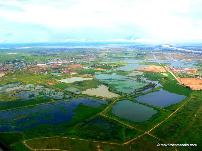 A view of the outskirts of Phnom Penh through the plane window.