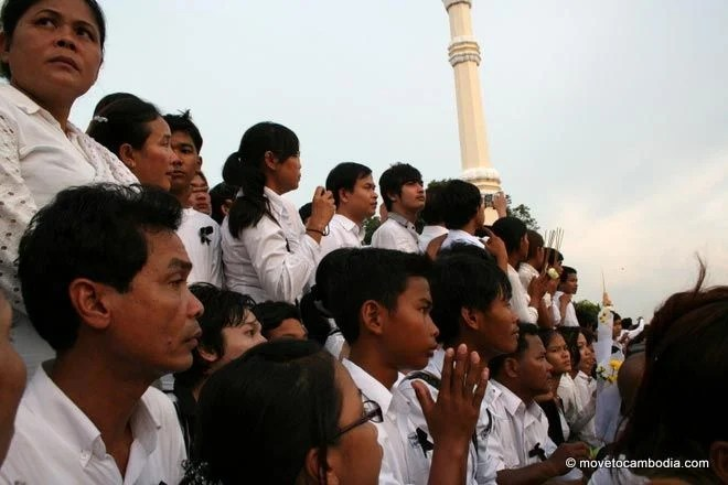 A young boy waits for hours to see King Father Norodom Sihanouk's casket return to Phnom Penh.
