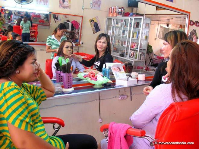 A Cambodian wedding guest gets her hair and makeup done at a Phnom Penh salon.