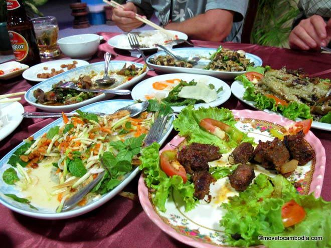A packed table at Bopha Leak Khluon Restaurant in Siem Reap