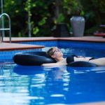 Kristin O'Connell relaxing in a pool