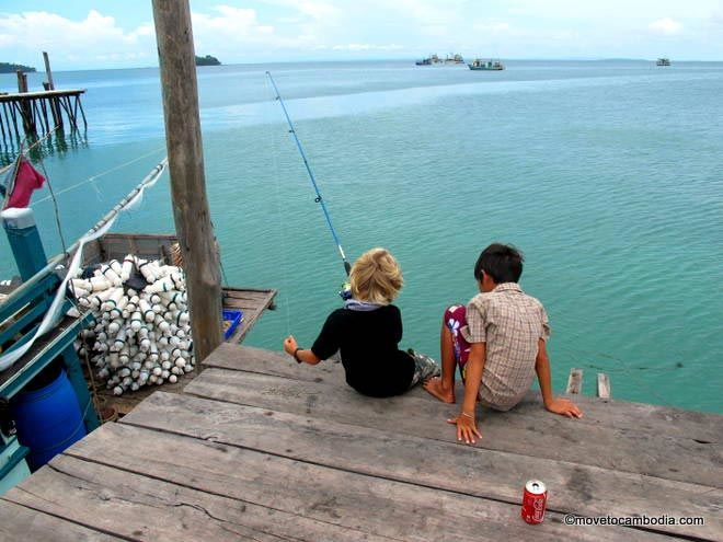 A couple of kids fishing off the Koh Rong pier.