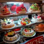 A selection of popular birthday cakes in Cambodia.