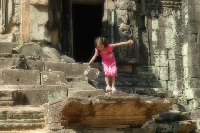 child at Angkorian temples