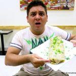 A La Cita medium burrito that is the size of a small child.