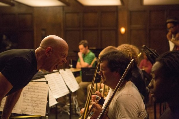 J.K. Simmons reprises his original role from the short as a ruthlessly demanding conductor