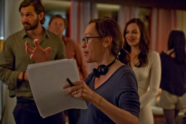 Director Karyn Kusama on the set of The Invitation with actors Michiel Huisman, Jay Larson and Tammy Blanchard