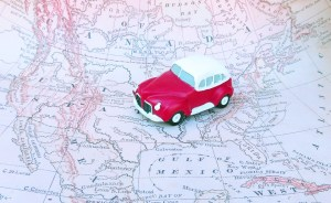 Red toy car on a map of the US.