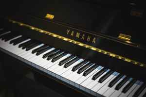A black Yamaha piano to be relocated by piano movers NJ.