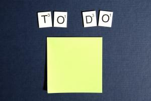 a yellow sticky note with to do letters