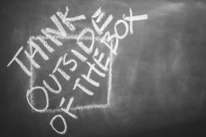 think outside of the box written with chalk on a board