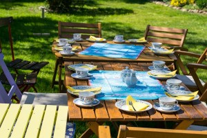 A table set for a outdoor dining and BBQ is a great way to celebrate a short-distance relocation.