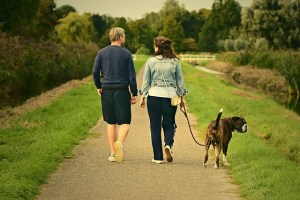 Man and woman walking the dog