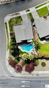 An aerial view of a suburb house with a swimming pool.