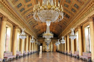 A room with multiple chandeliers for chandeliers movers NJ to relocate.