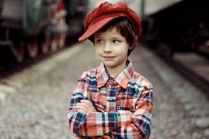 A little boy wearing a cap.