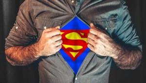 A man wearing a Superman shirt.