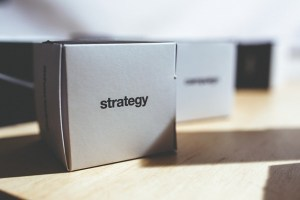 Box with strategy sign on it
