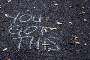 """""""You got this"""" written in chalk on concrete."""