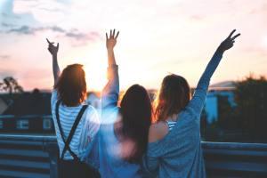 Three girls on a balcony.