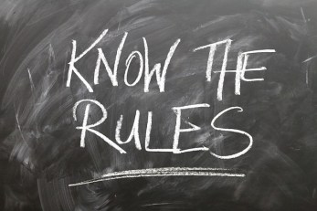 """know the rules"" written on a blackboard"