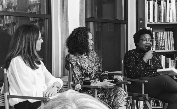 Brooke Foucault Welles and Sarah J. Jackson look on as I talk into the mic at our book tour launch at the Strand Bookstore in New York City.