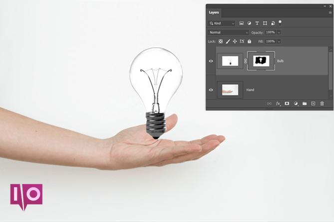 Image masquée du calque Photoshop de la main et de l'ampoule