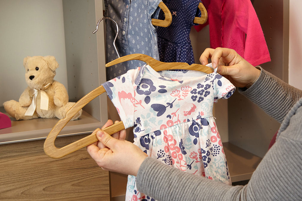 Bamboo Mozu Hanger being used on infant clothes