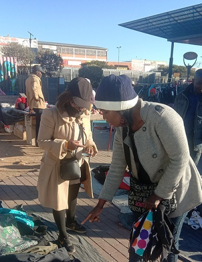 South African young lady, Miss Lumka Dhlamini (left), a holder of Jewellery Design and Manufacturing degree is seen here selling jerseys and jackets outside Pan Africa Mall in Alexandra. Photo by Savious Kwinika, CAJ News