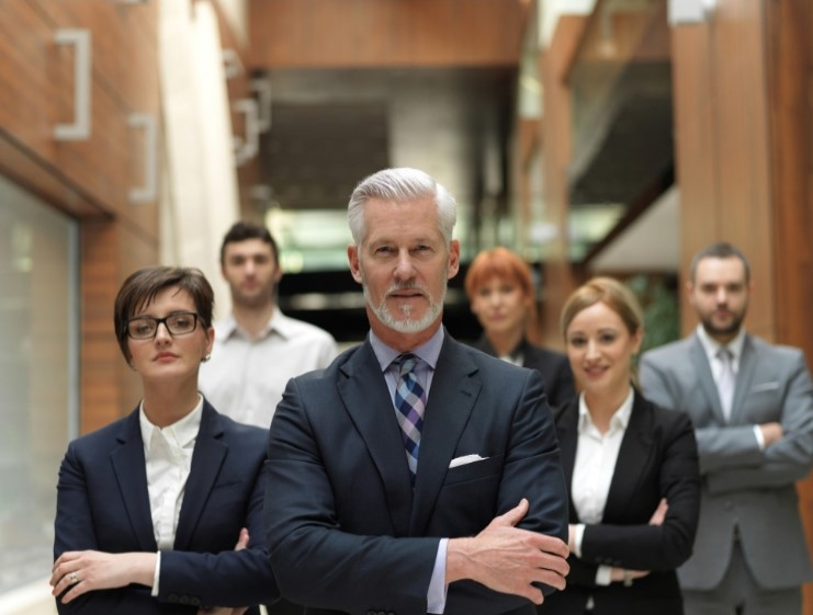 Business People Standing Behind each other with arms crossed