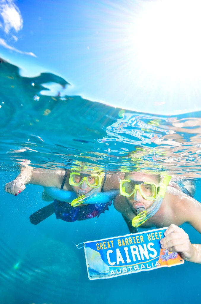 Mum and me snorkelling the Great Barrier Reef near Cairns