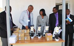 Flourescent microscopes are capable of identifying at least 10% more TB cases than conventional light microscopes. From left: Professor Tumani Corrah; Hon Fatim Badjie - Minister of Health; Dr Makie Taal – Director, National Public Health Laboratories; Mr Adama Jallow – National Leprosy & TB Control Programme.