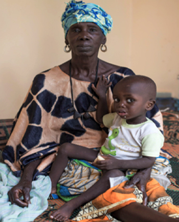 Grandmother with a child receiving nutritional rehabilitation