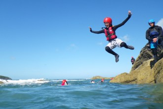 Coasteering for kids cliff jump
