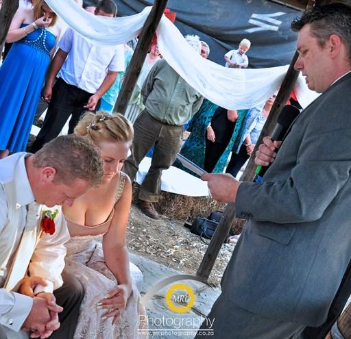 Priest, bride & groom