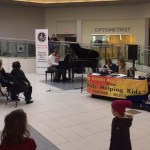 A student performing to an audience at Musicthon 2018