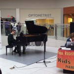 A stuend playing piano at Musicthon 2018